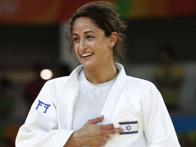 Israeli medalist auctioning autographed Olympic name patch for charity The Jerusalem Post